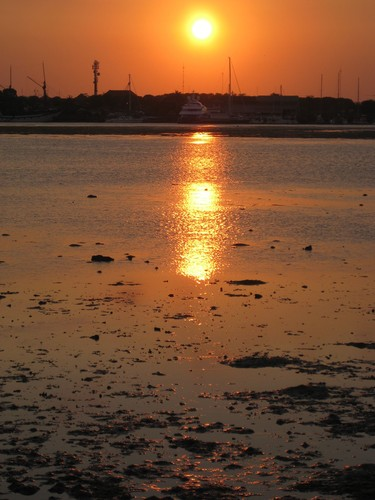 the_sun_setting_at_Serangan_Island__Benoa_Bali_Harbour