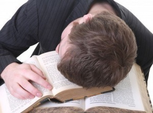 6186928-student-sleep-on-book-he-is-studying-male-tirred-from-reading-and-abandon-it-to-fatigue